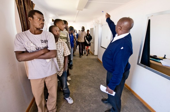 A Zimbabwean immigration official addresses a room of would-be migrants deported from Botswana for illegal immigration.