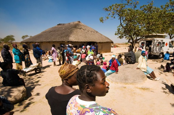 Residents of the Caledonia township south of Harare queue for attention from an IOM-sponsored mobile clinic. The twice-monthly clinic is the only access Caledonia's 2000 residents have to medical care.