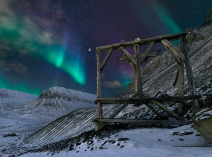 Lightscape: Aurora dance over the wooden carcass of an old mining tramway at the southern end of Longyearbyen. With a population of 2000, Longyearbyen is the only sizable pocket of humanity for 1000km in any direction, including north, where it's the last civilian settlement of any sort before the North Pole.