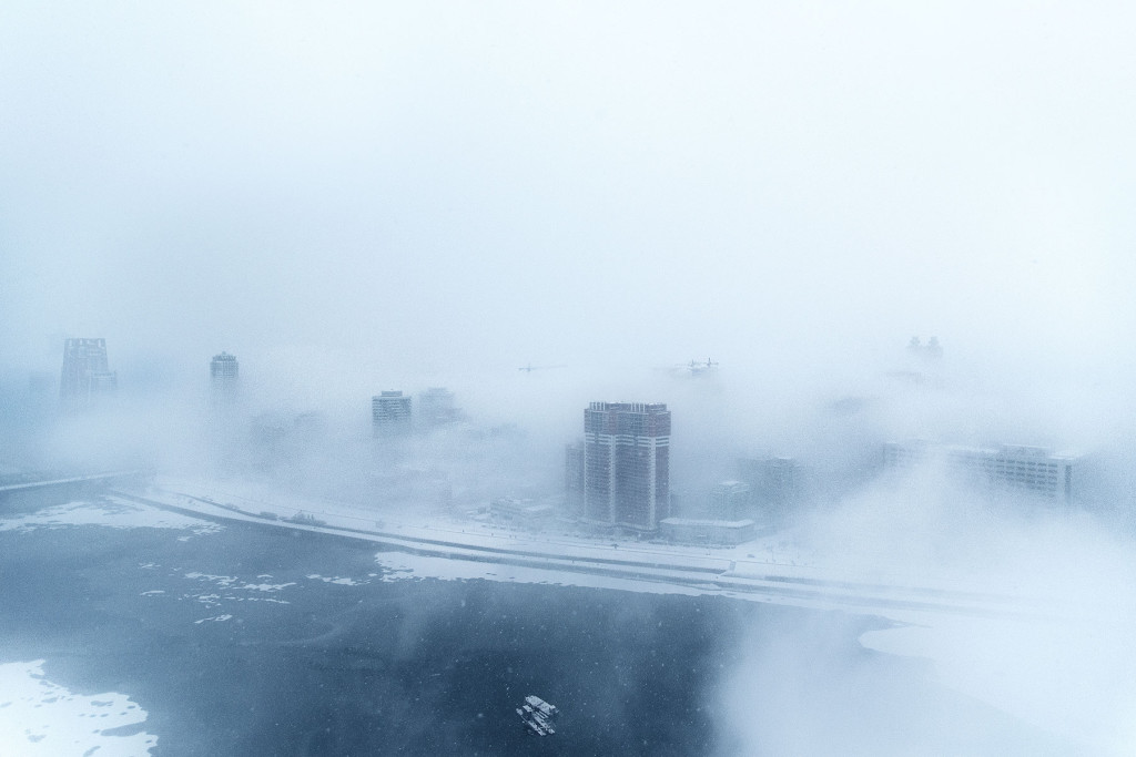 Whorls of storm weave through the streets and towers of central Pyongyang.
