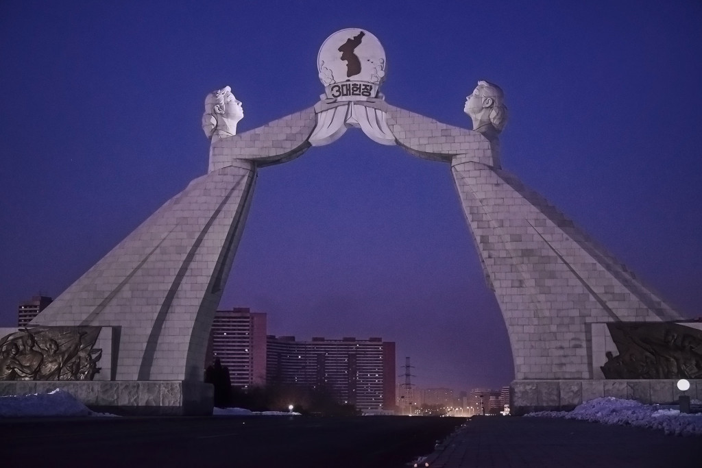 Two thirty metre-tall women hold dedicated to the proposals of President Kim Il-Sung for Korean reunification.