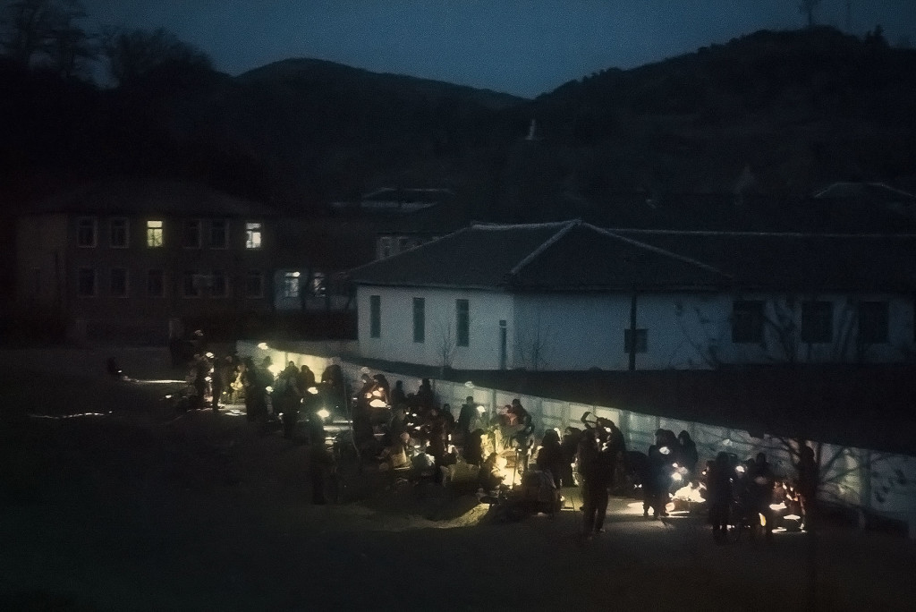 Jangmadang: A black market springs up at dusk on the outskirts of a small town in South Hamgyong province. Though officially illegal, informal commerce has been increasingly tolerated since the famine of the 1990s.