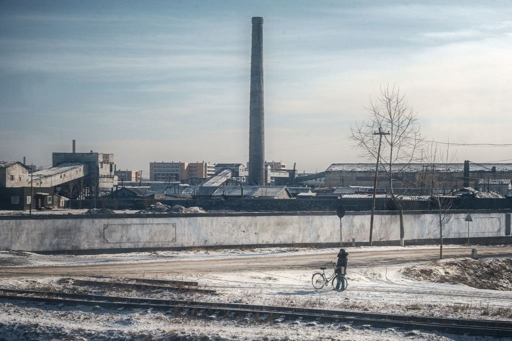 "Concrete Sentinels: An industrial chimneyscape looms over North Korea's ""City of Iron"", the manufacturing centre of Chongjin."