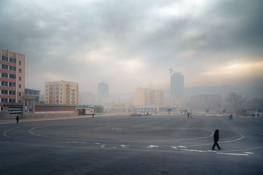 A coal-fired haze obscures the rising skyline of Rajin, a trading hub near the Russian border in the country's northeast.